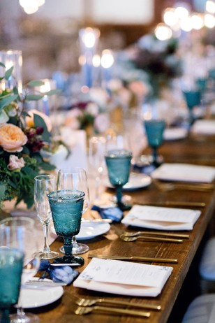 gold and blue family style wedding reception seating