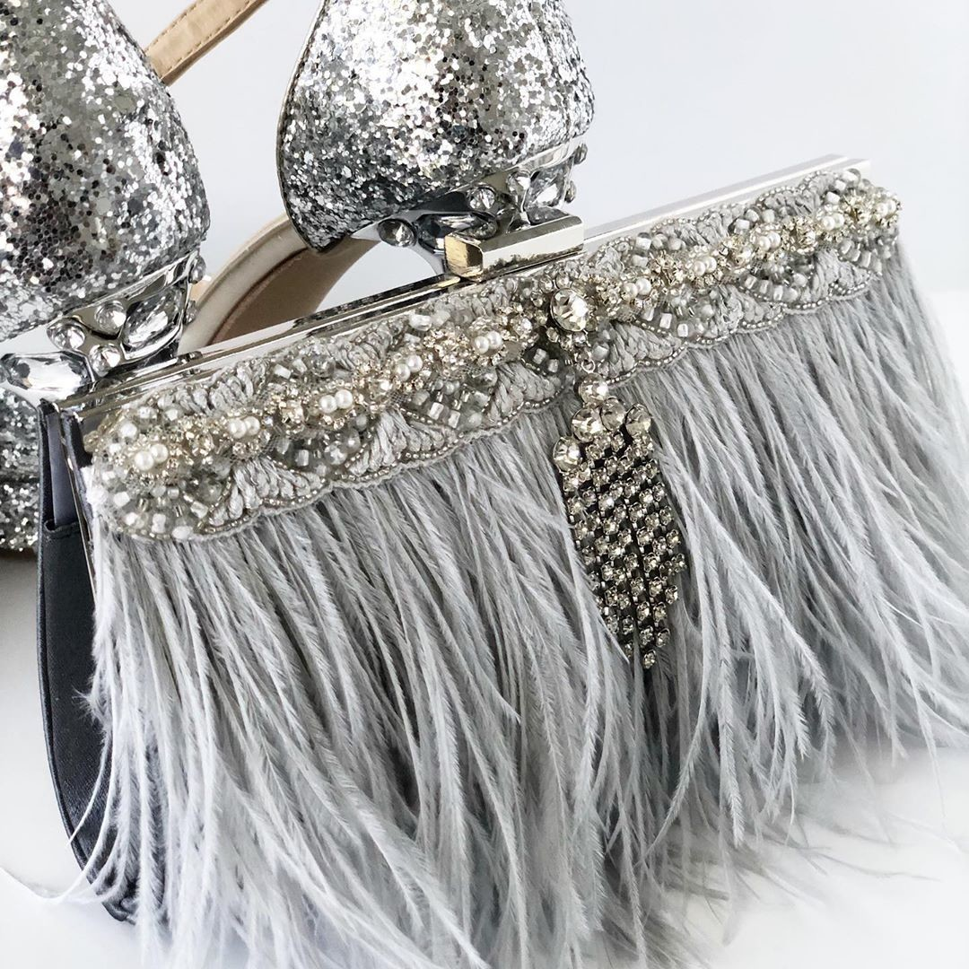 Mother of the bride ready with this gorgeous brand New gray ostrich feather clutch.