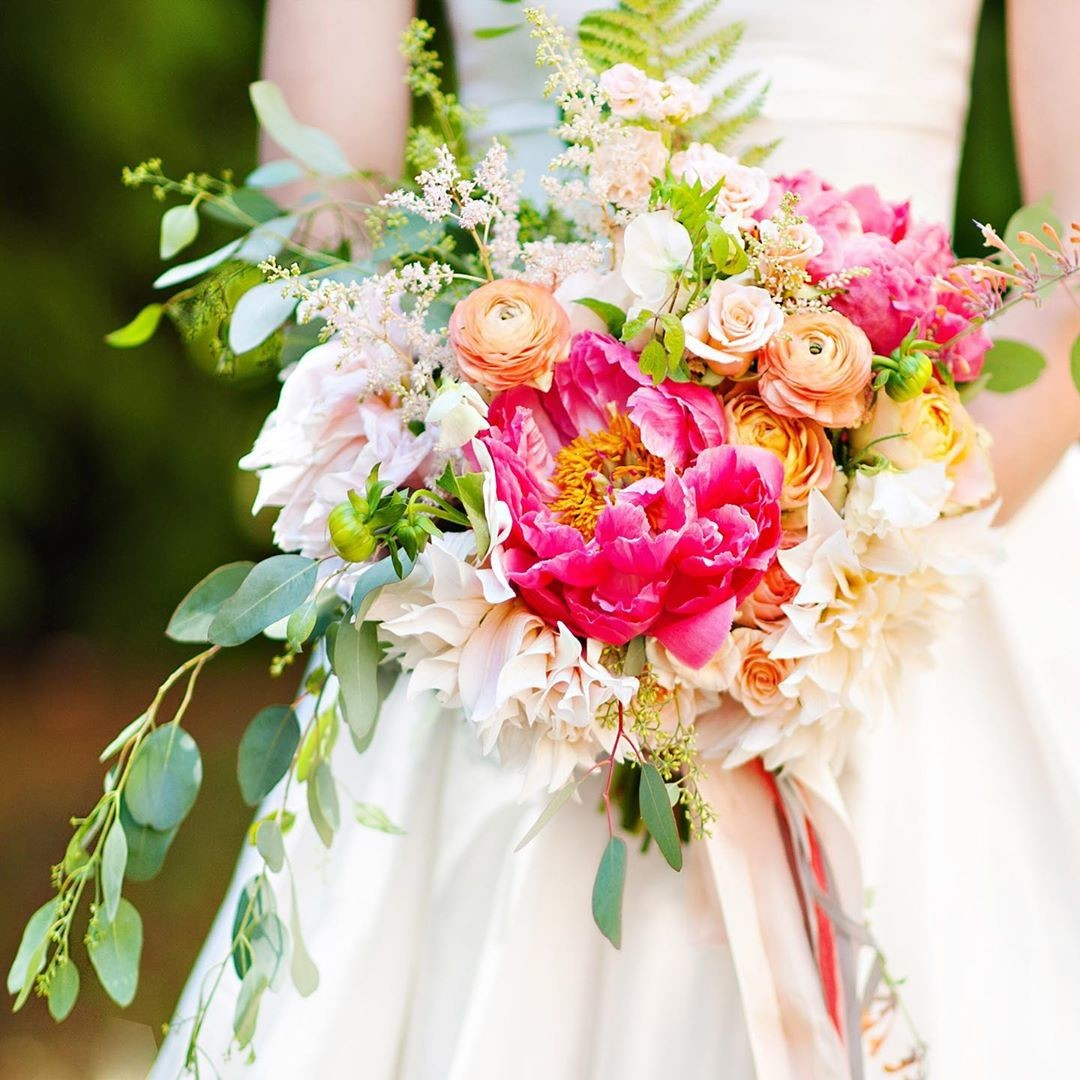 With summer finally here, all the colors around us are incredibly inspiring. Here, our bride's stunning bouquet is a perfect complement