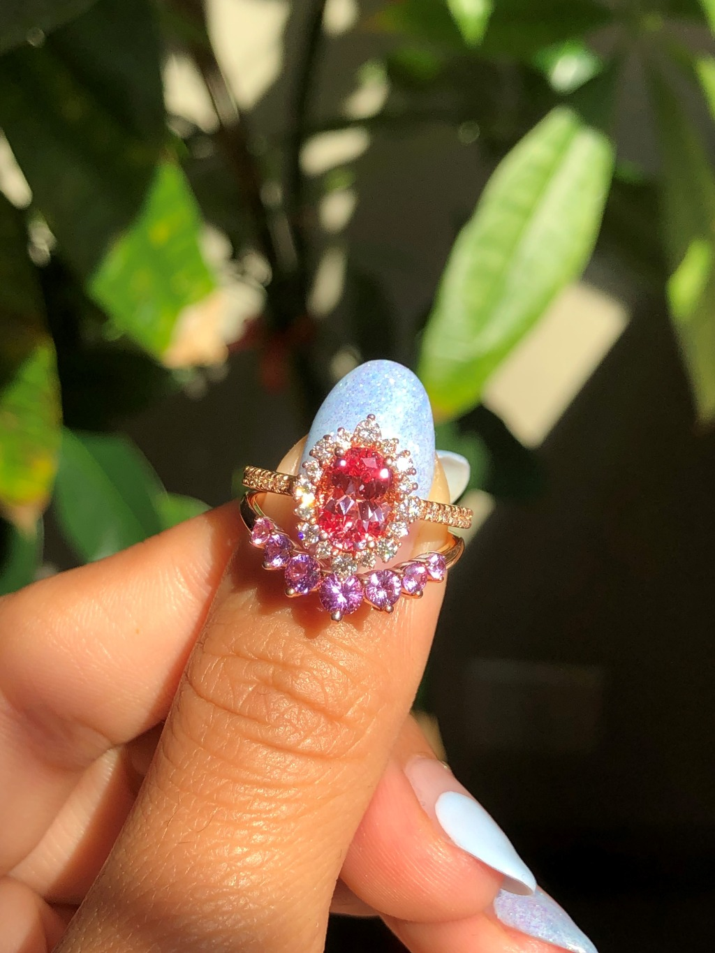 Breathtakingly gorgeous Sapphire Bridal Ring Set features a 8x6mm oval cut Champagne Peach Sapphire set in 14k Rose Gold Tiara Halo
