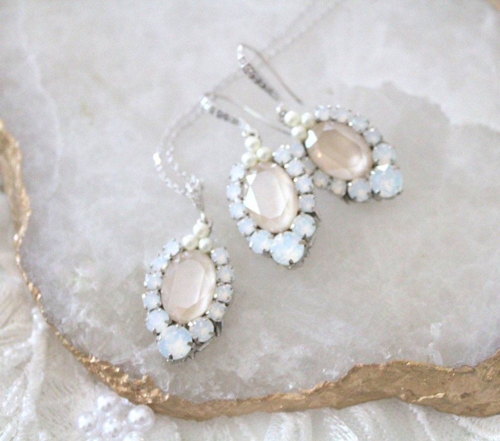 Swarovski crystal bridal earrings. Center stone is Ivory cream surrounded by Swarovski white opal and clear stones. Just a hint of