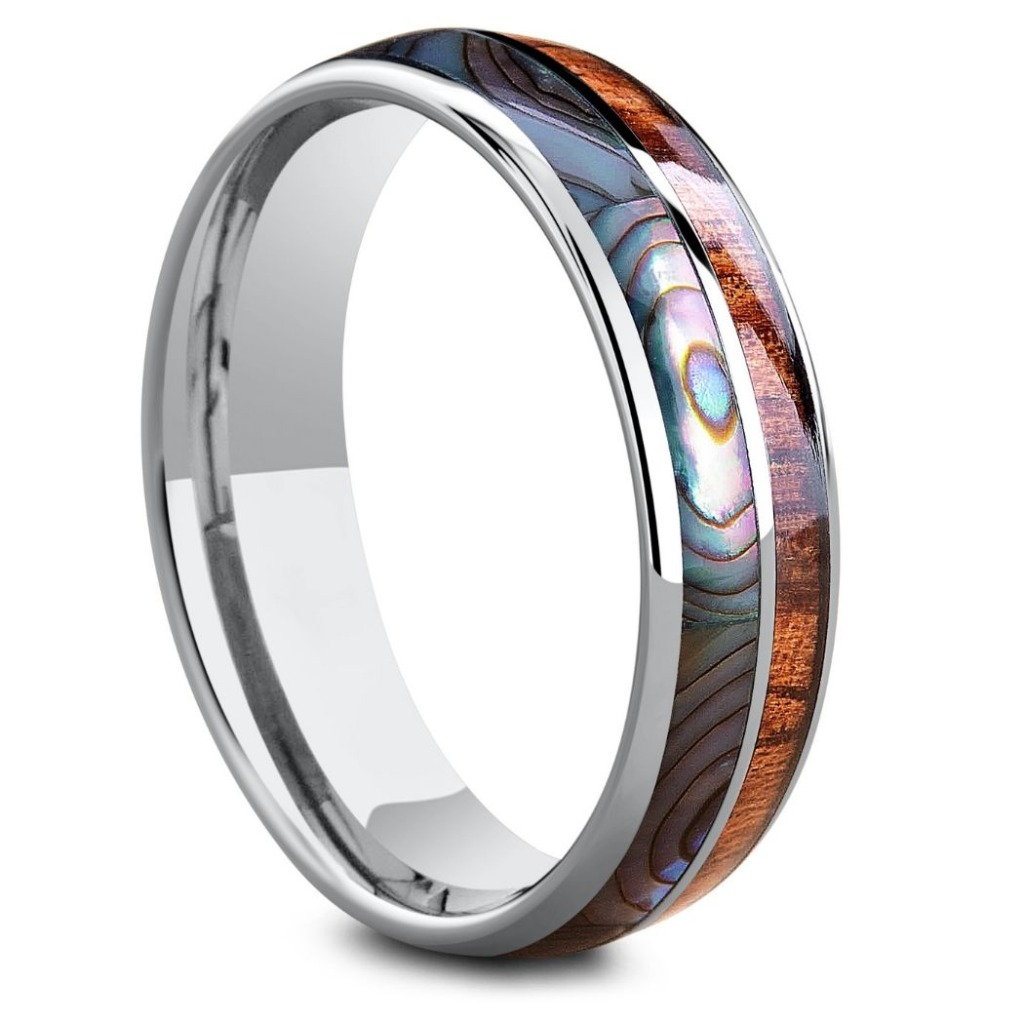 Mens or women's wooden wedding ring with abalone. Crafted out of tungsten carbide. This makes the perfect mens or womens wedding band