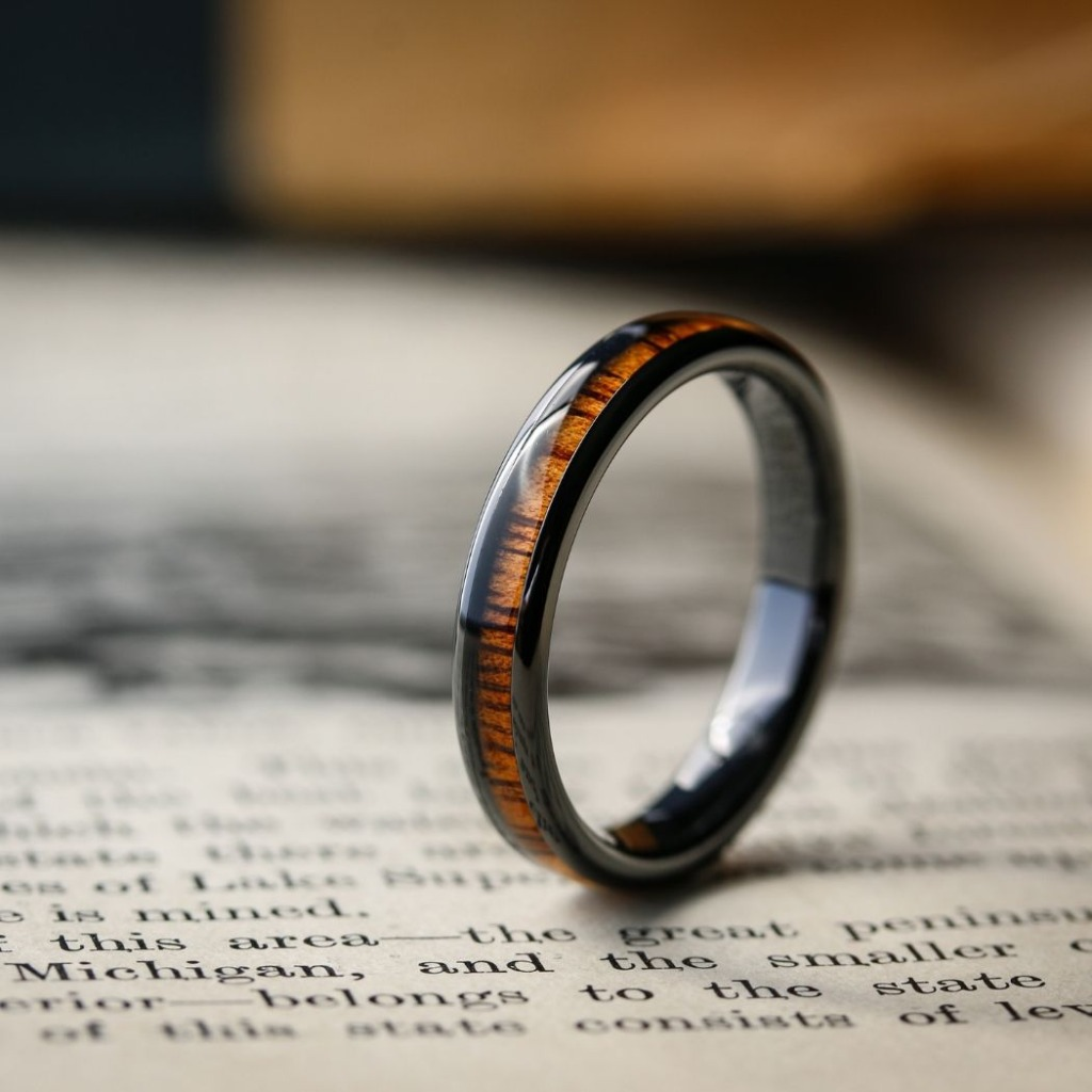 Women's wooden wedding ring crafted out of high tech ceramic and inlaid with natural koa wood.