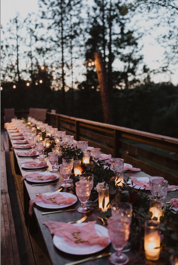 Pops of blush pink, simple greenery, and the twinkling of candles all set against the gorgeous backdrop of the setting sun in Yosemite