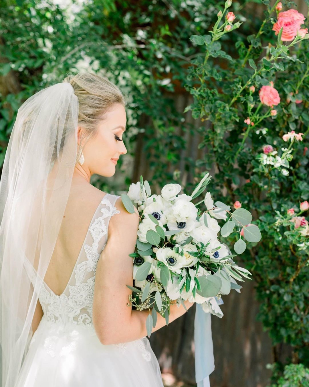 Beautiful bride among greenery