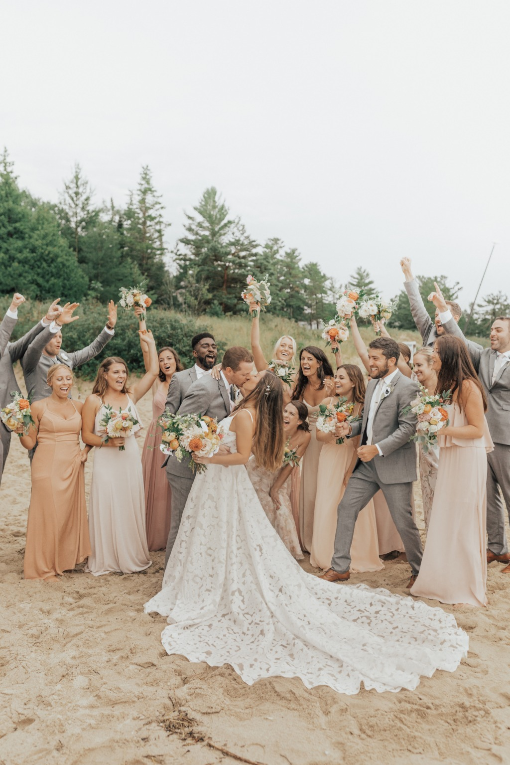 It POURED for 5 hours on their wedding day. Everyone stayed in the happiest of spirits. The rain slowed down during their ceremony