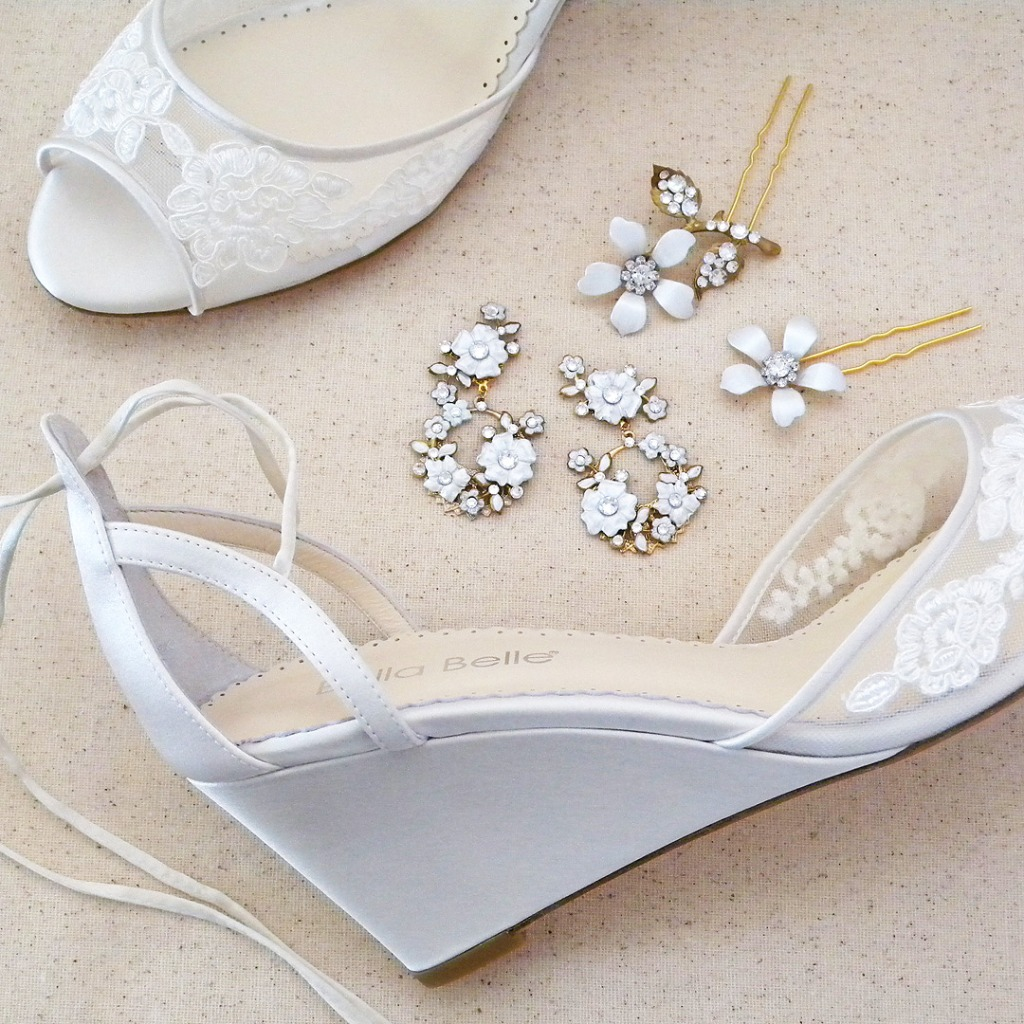 Adorable as practical, a lace wedge wedding shoe that brings romance and style. Lace appliques adorn sheer mesh at the toe, making