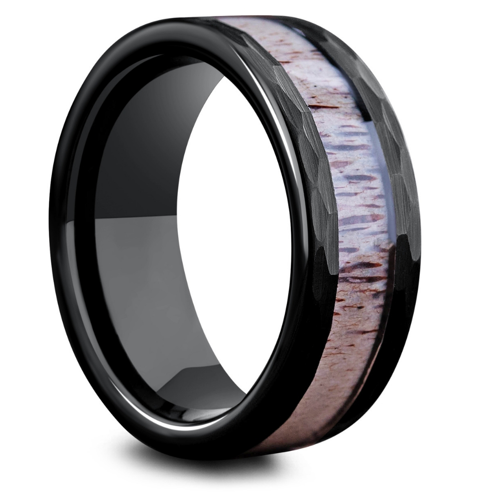 Men's Deer Antler Ring. This men's antler ring is crafted out of a black tungsten carbide core. Features hammered sides. Super durable
