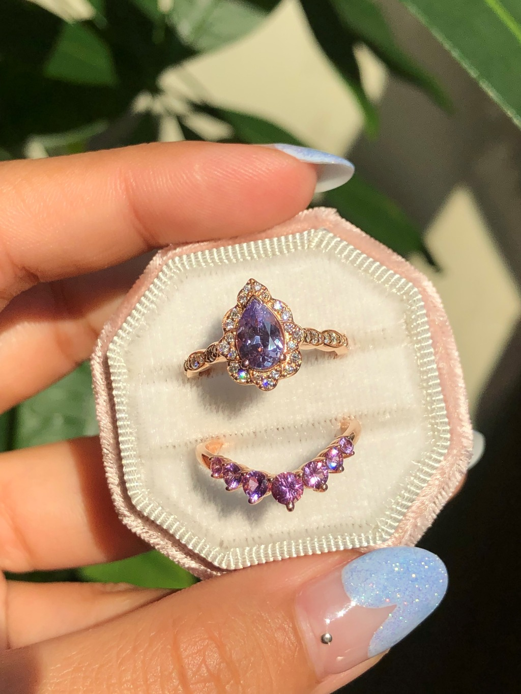 Artfully crafted purple sapphire bridal set features a 1.00 carat pear lavender purple sapphire engagement ring set in rose gold vintage