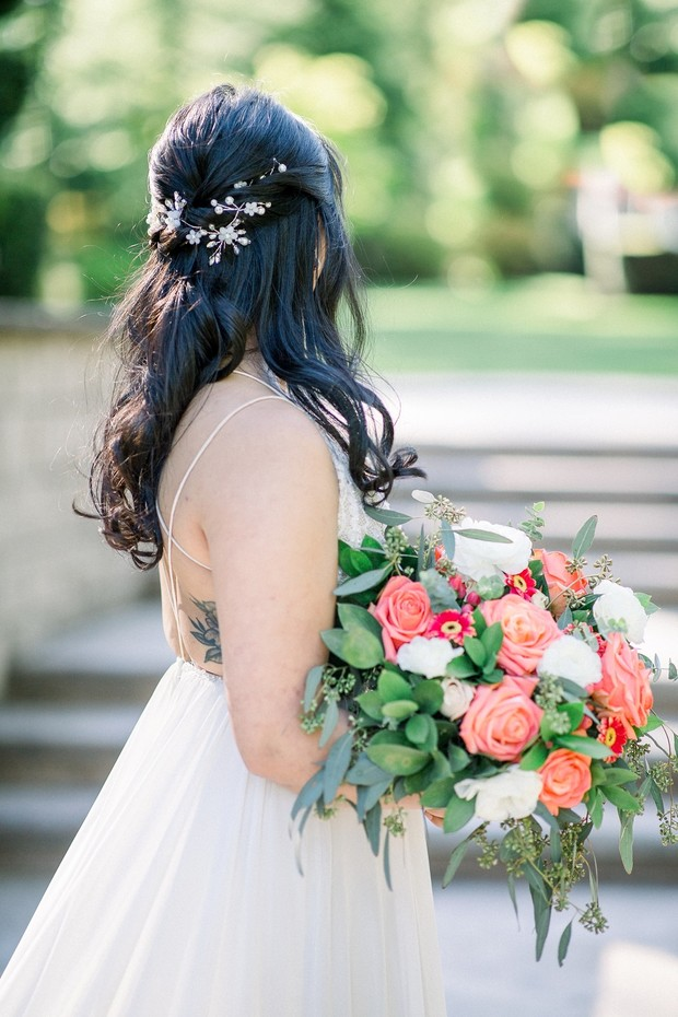 bridal half up hair with coral bouquet