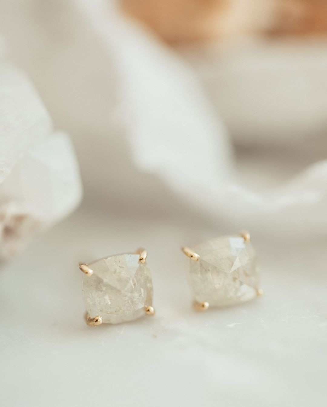 Currently crushing on these light grey rough diamond studs in 14k yellow gold. Available online and at our Tennyson street location
