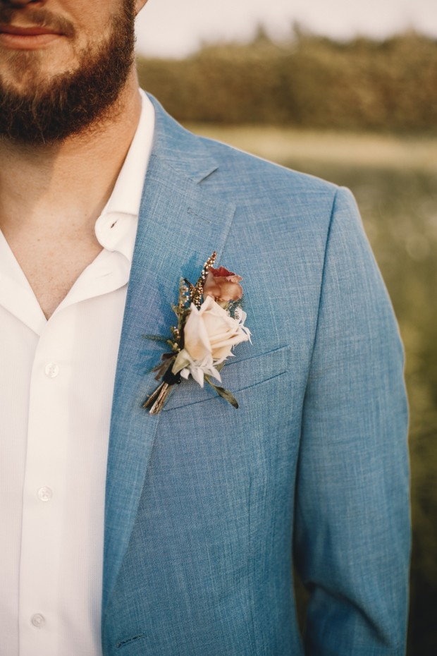 rose boutonniere for the groom