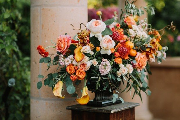 orange and coral wedding floral decor