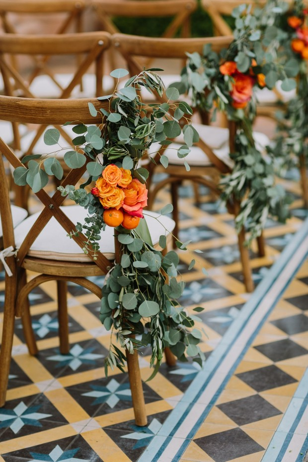 eucalyptus orange and rose wedding aisle decor