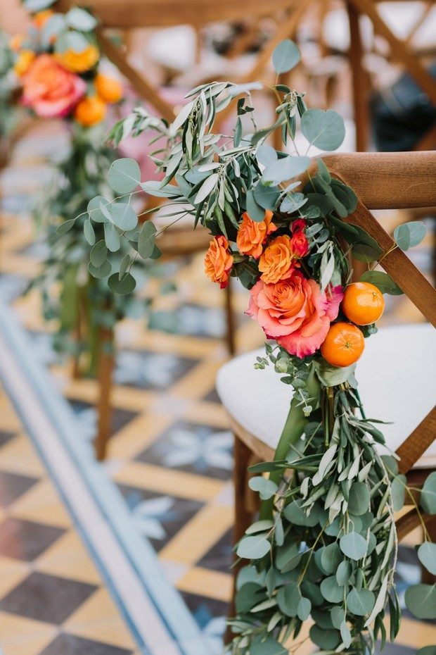 orange and coral floral aisle decor
