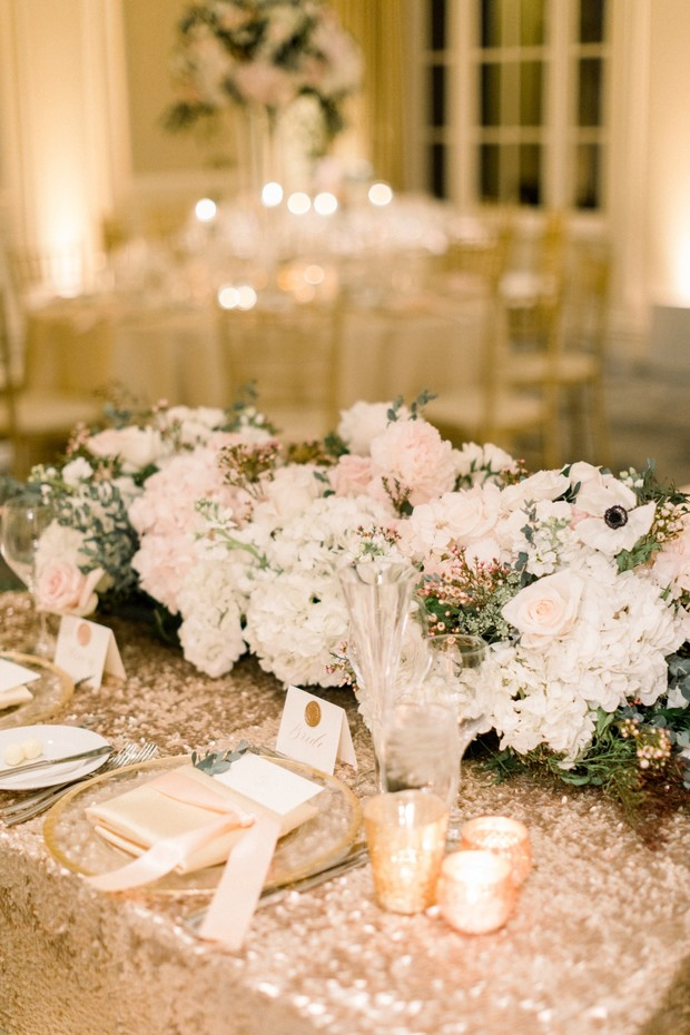 glittery blush and gold wedding sweetheart table