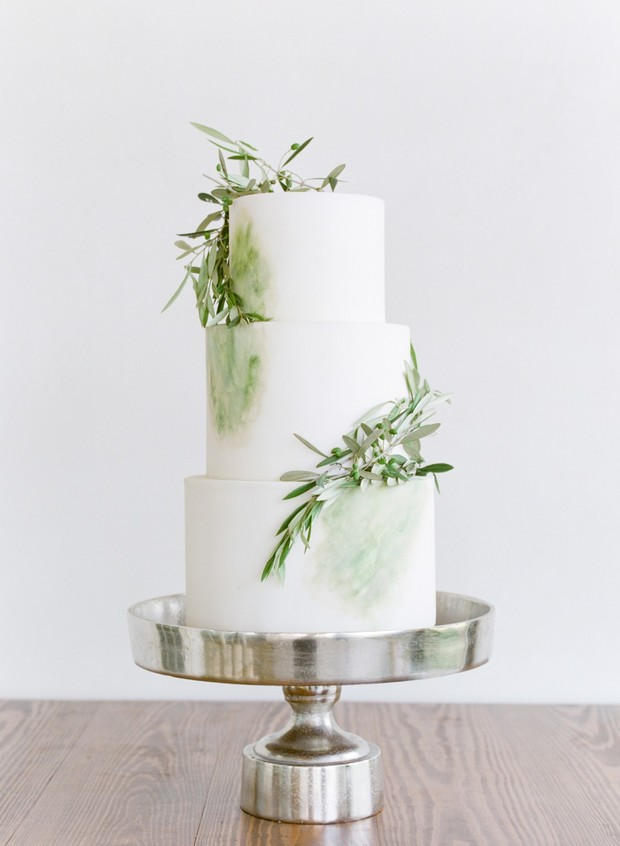 olive branch decorated wedding cake
