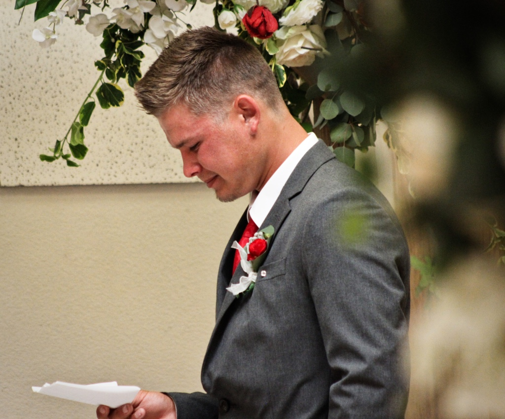 Groom reading vow with tears