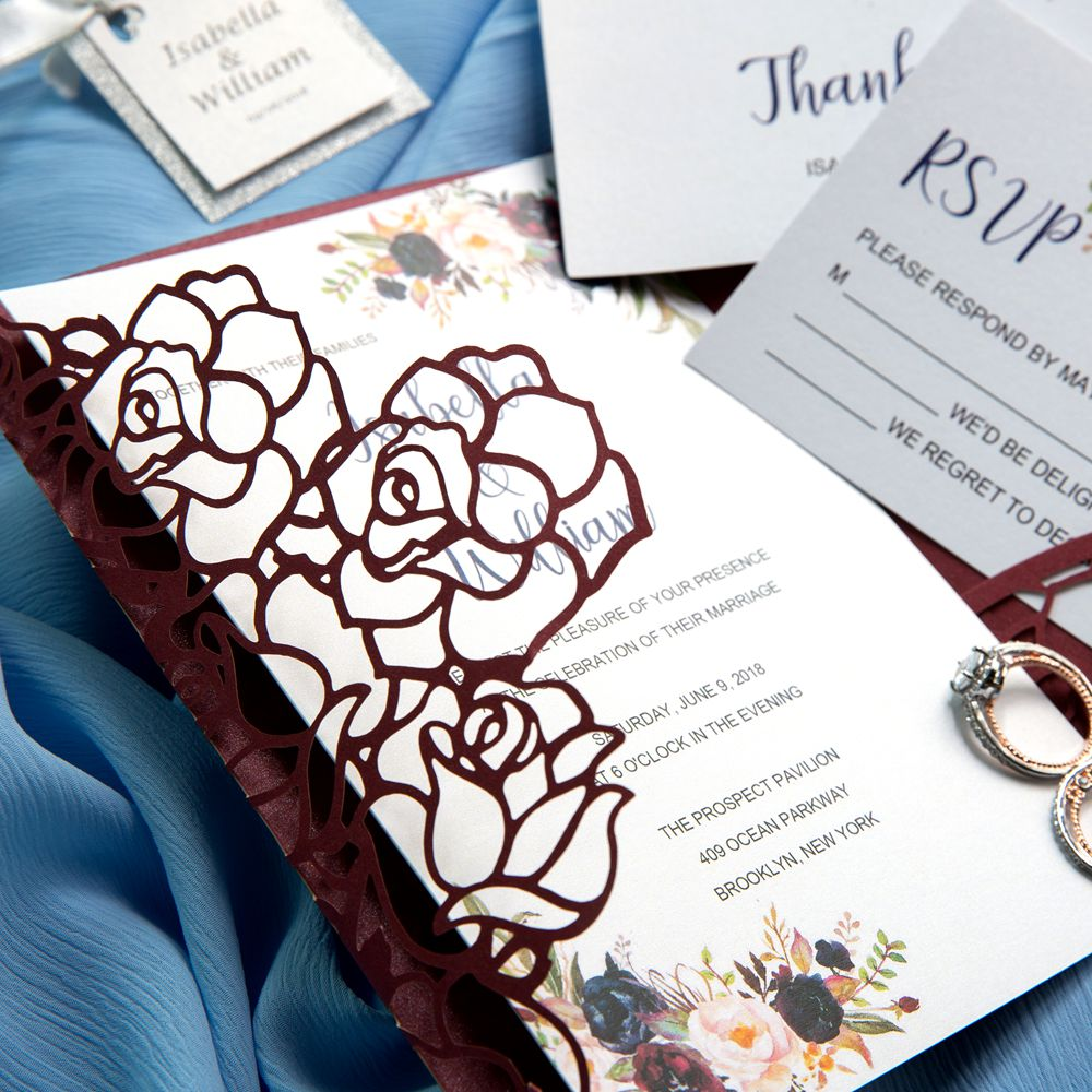 This Burgundy Laser Cut Wrap is Tied up With a Gold Shimmery Belly Band and with a Personalized Tag. The initial touch of the sleeve