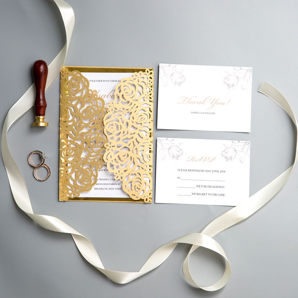 This invitaion is so charming with its intricate rose-like pattern. And inside it features gold foil paper as background, setting the