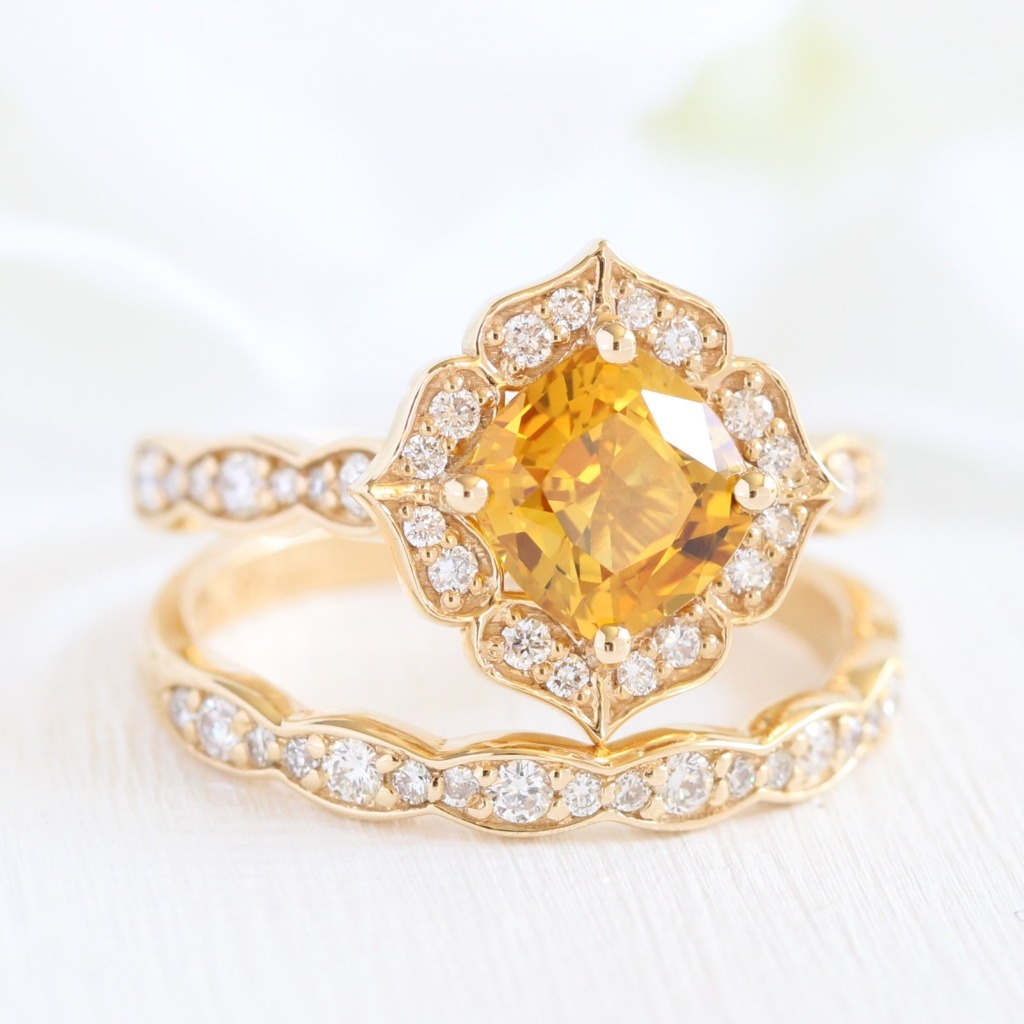 Stunning and Unique Bridal Set of La More Design. This vintage floral bridal set showcases an engagement ring with a cushion cut natural