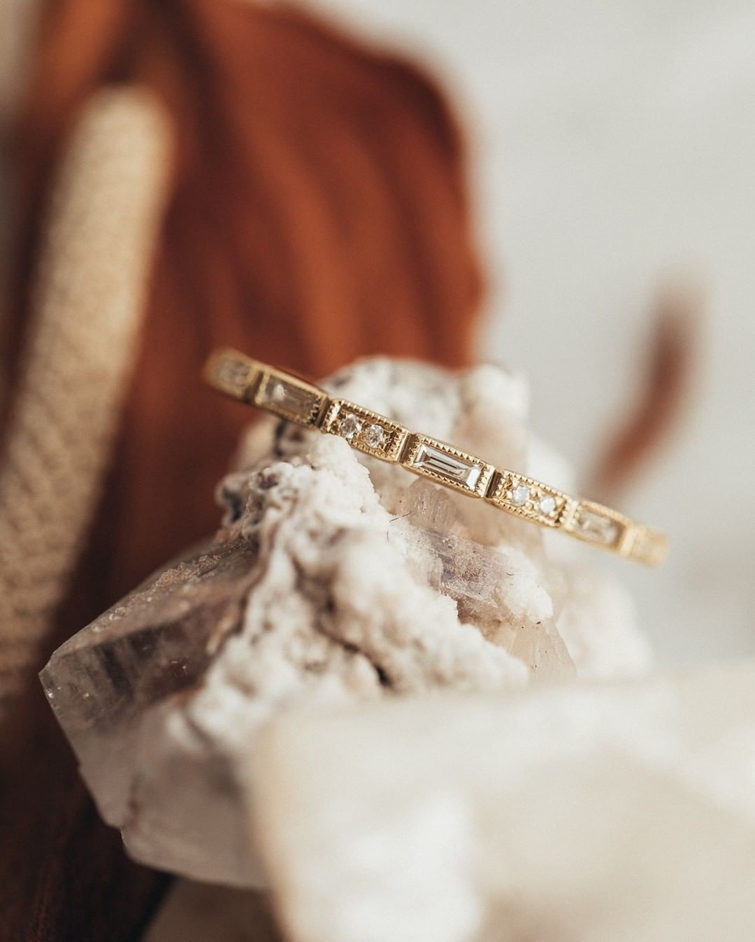 We've got a huge crush on baguette diamonds, especially set in a milgrain 18k yellow gold band.