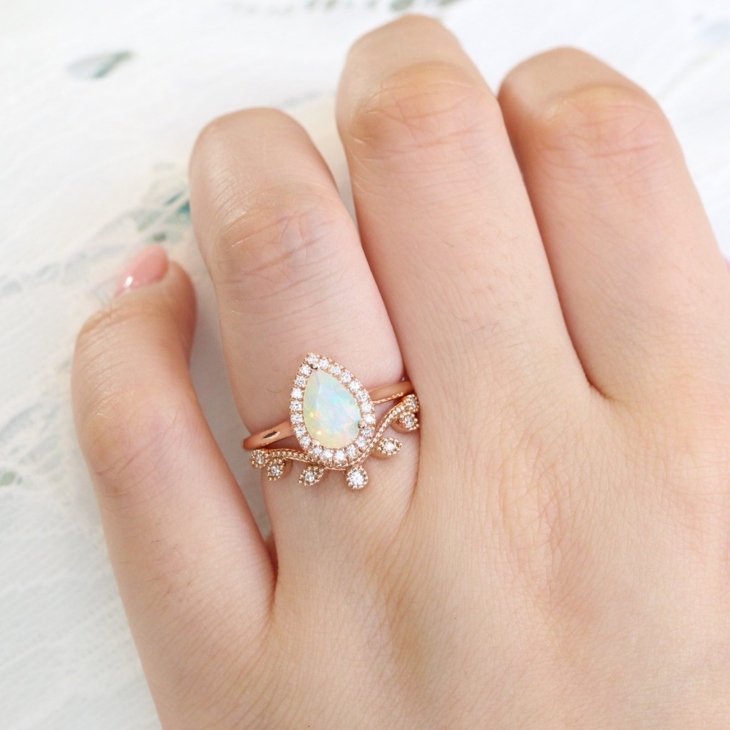 truly one of a kind ring set ~ Luna Halo Opal engagement ring in rose gold nests perfectly with gorgeous curved diamond leaf wedding