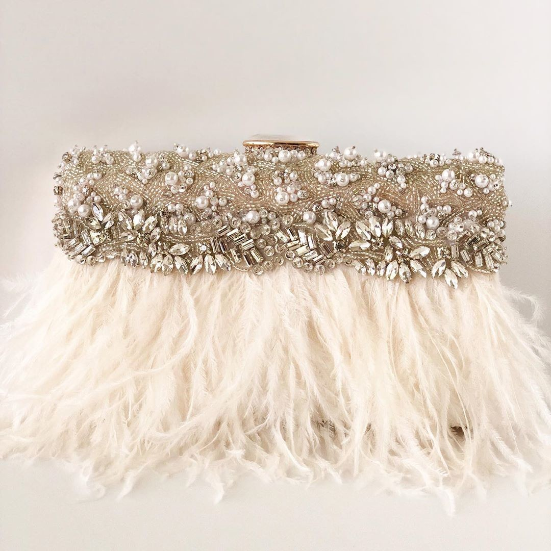 I am in LOVE with the rhinestone and pearl details on this brand New bridal clutch. It's a