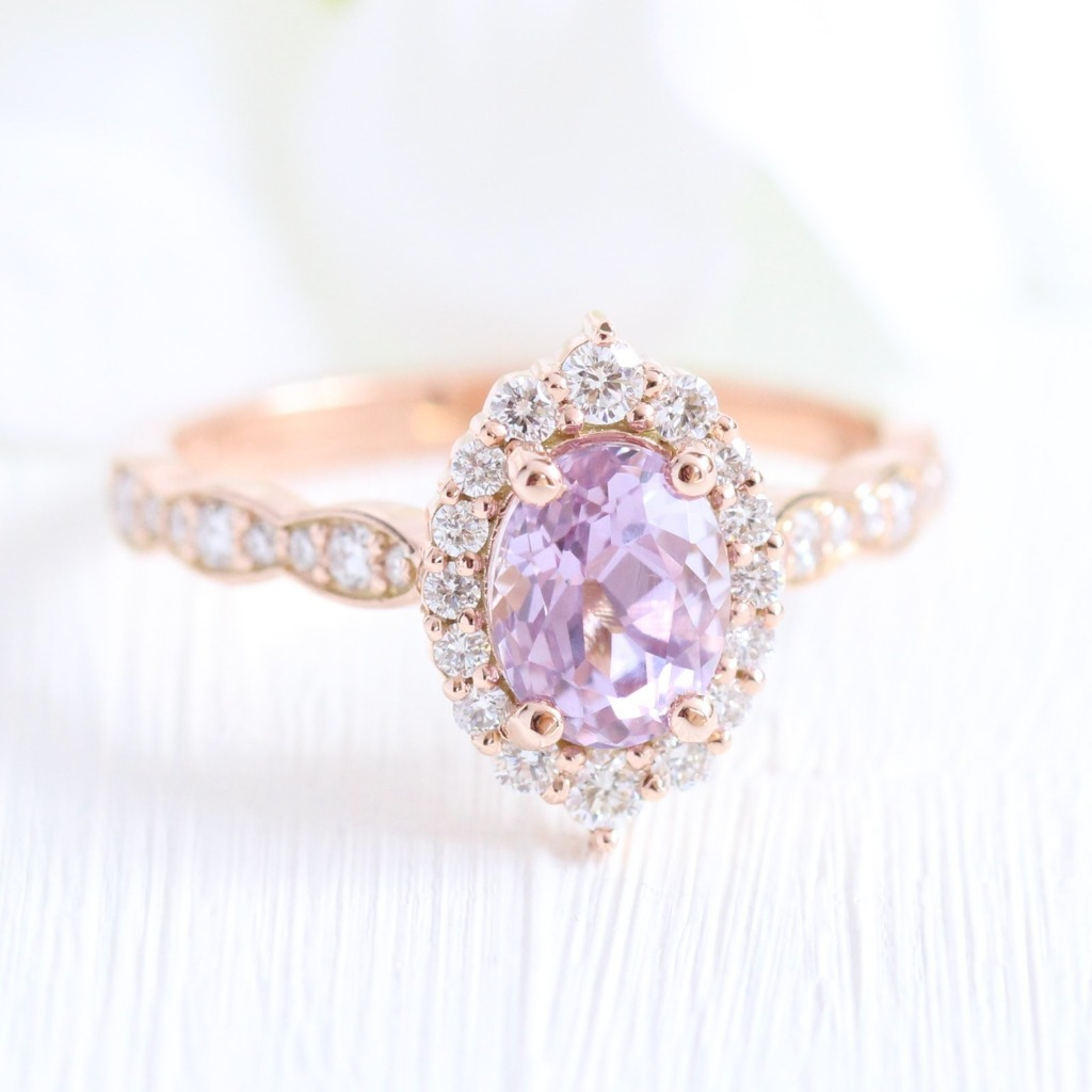 Beautifully Bewitching! This gorgeous one of a kind purple sapphire engagement ring is crafted in 14k rose gold Tiara Halo Diamond