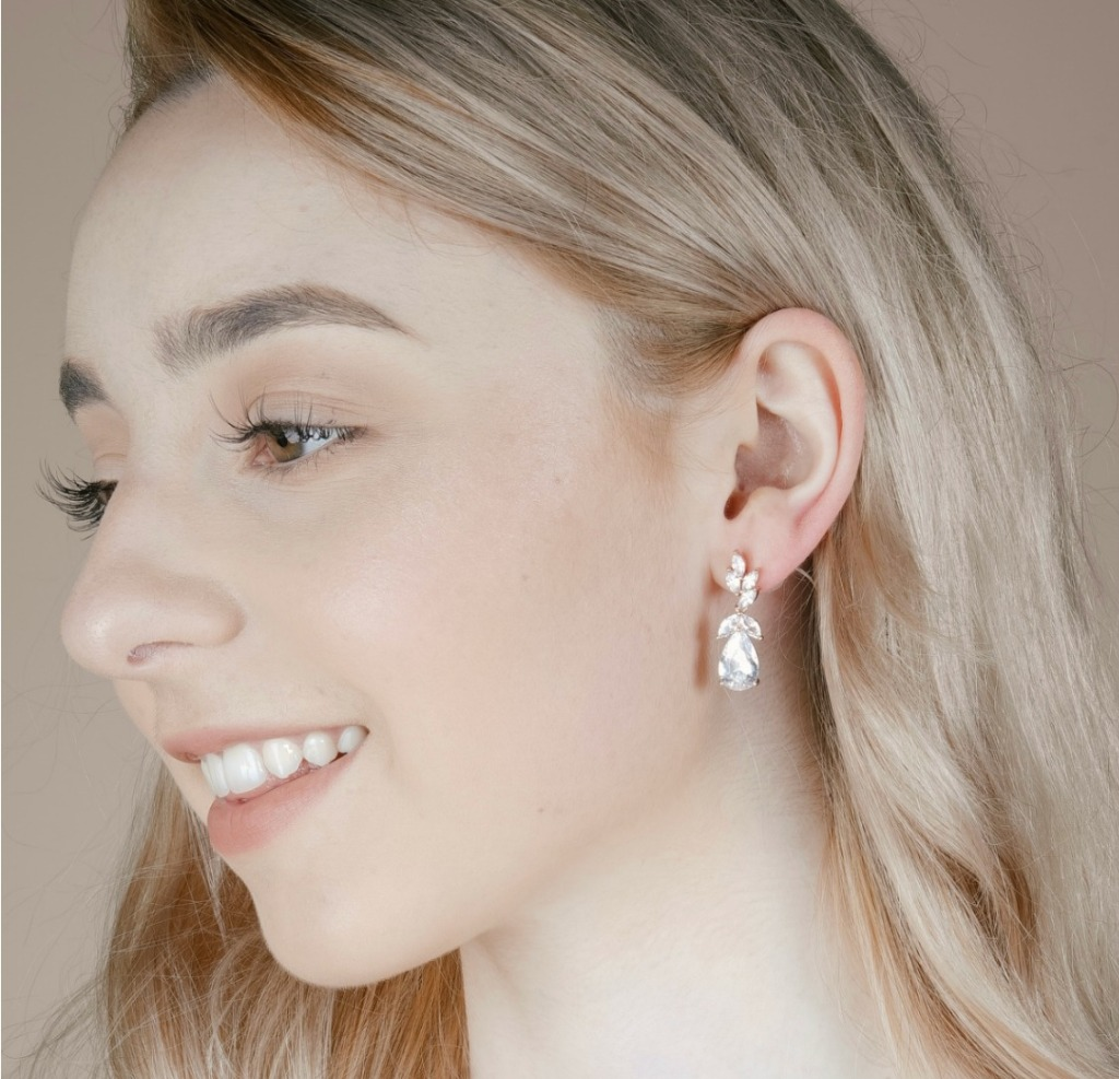 Bridesmaid earrings featuring cubic zirconia crystal clusters and teardrop pendant. The perfect accent accessories for bridesmaids