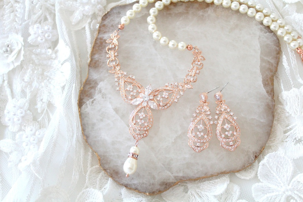 Rose gold finish Bridal necklace and earrings set with Swarovski pearls. Perfect for any bride or bridal party.