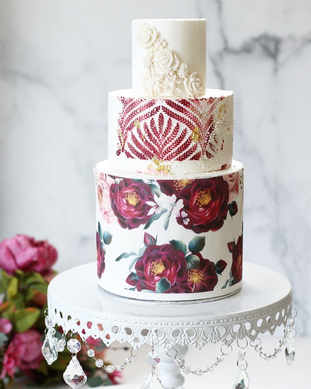 Opulent Treasures White Chandelier Wedding Cake Stand. Stenciled Wedding Cake with bas relief details by Christina's Cupcakes