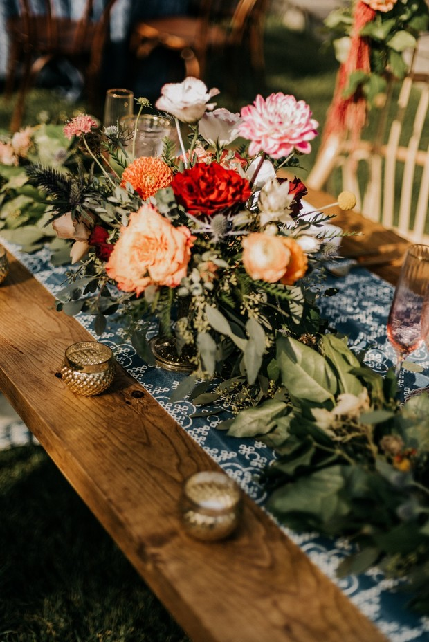 wedding florals and gold votives