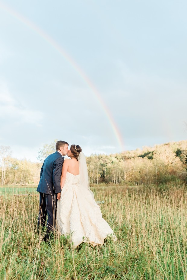 a wedding with a rainbow
