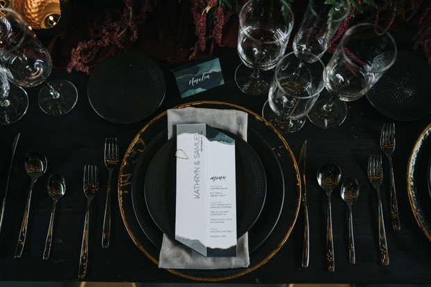 black and gold moody wedding place setting