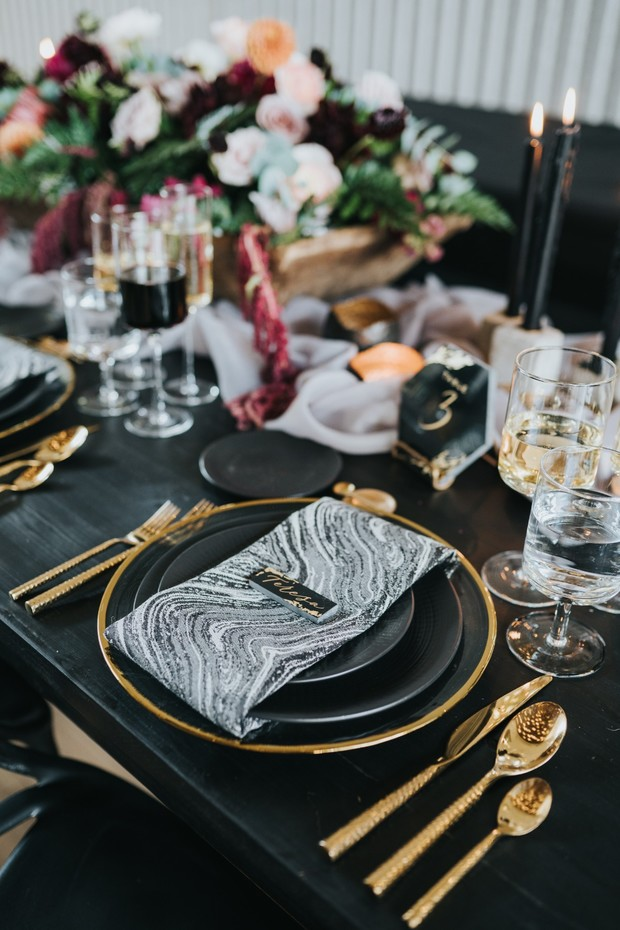 modern glam black gold and marbled wedding place setting