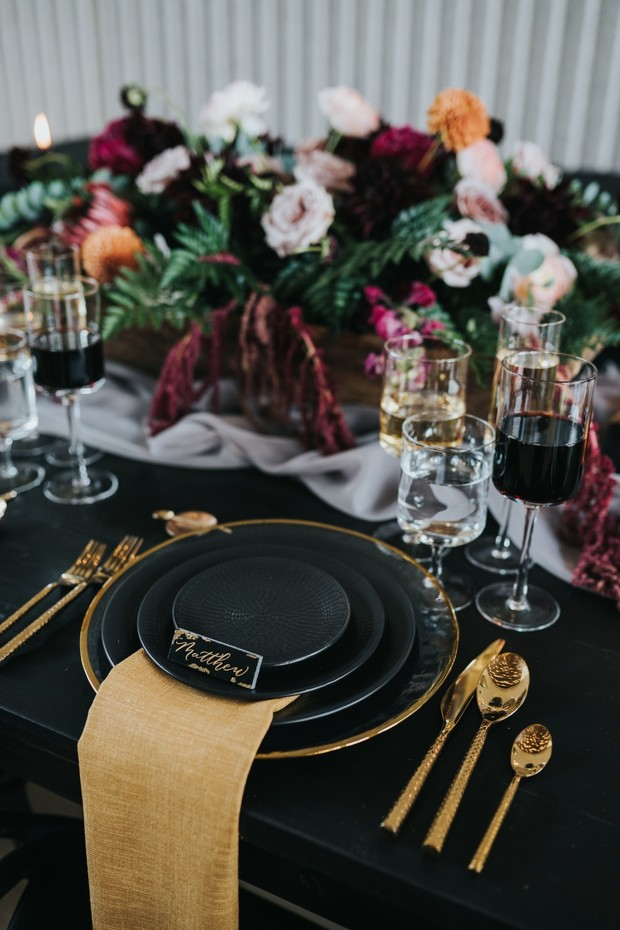 modern moody black and gold place setting