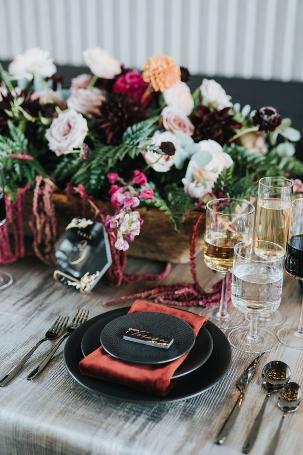 black and plush red wedding place setting