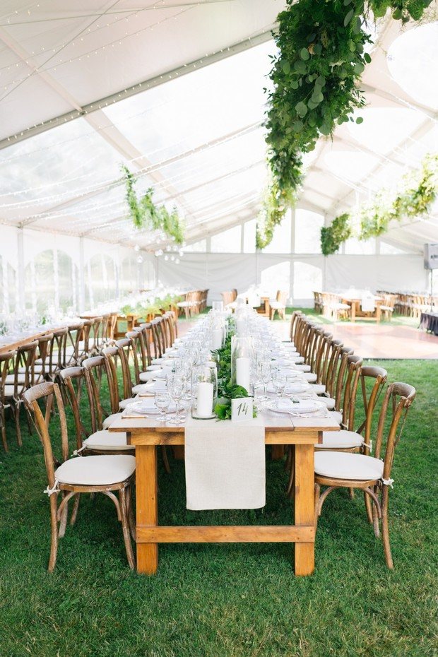 chic white and green tented wedding reception