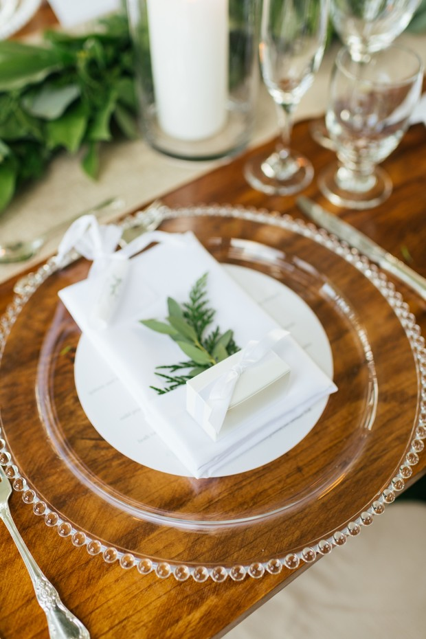 glass and white wedding place setting