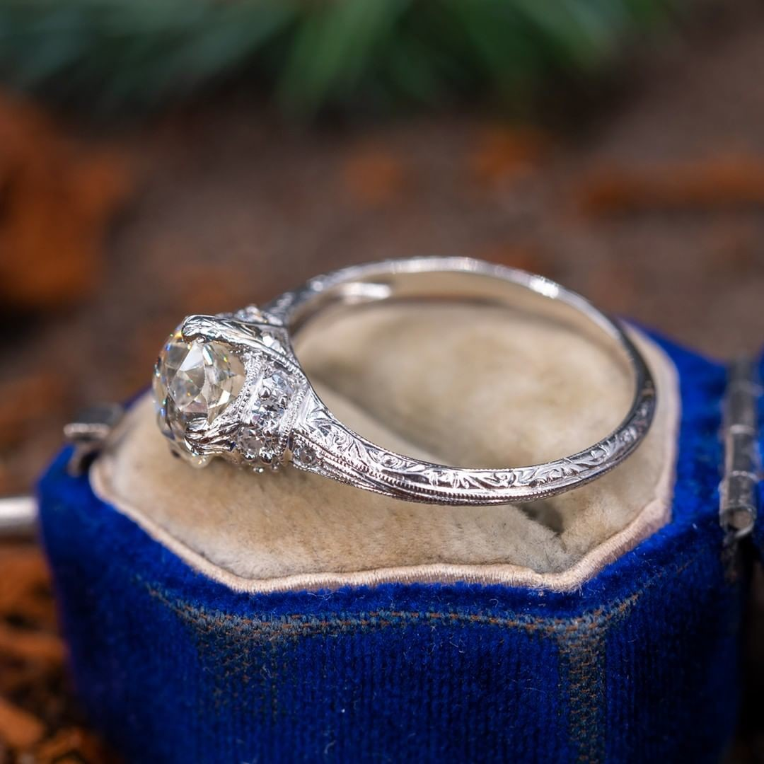 Engraved Antique Engagement Ring. Old mine cut diamond. Circa 1920s. The accent diamonds are round single cuts and the mounting is