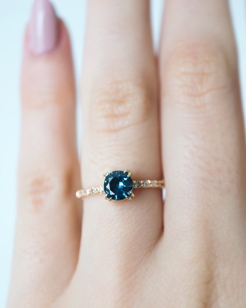 The classic Sapphire solitaire you've been waiting for is new to our online shop. 💙 A Blue Green Montana Sapphire, recycled Yellow