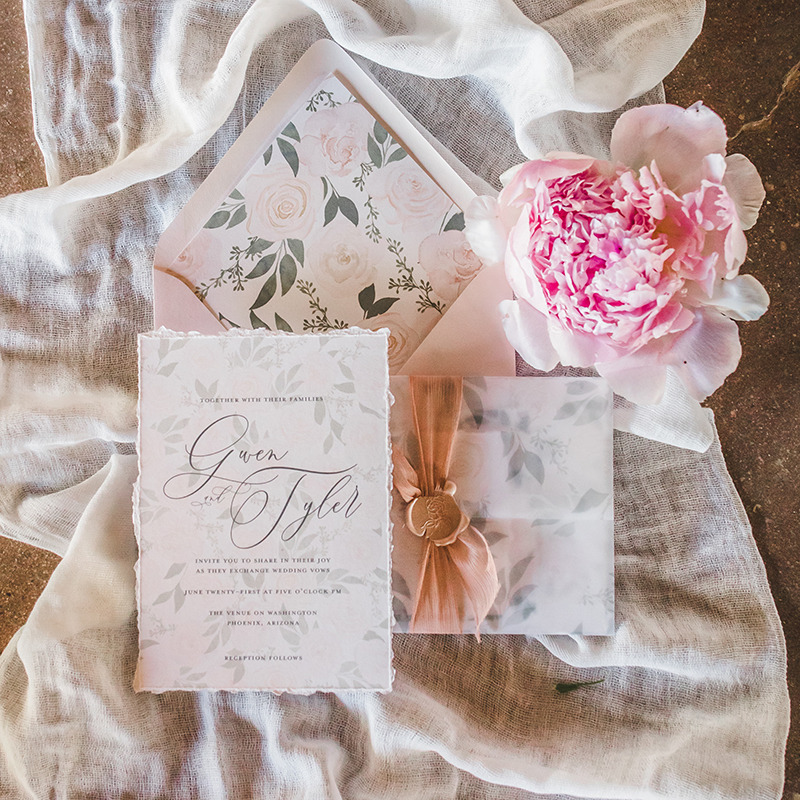 Take a muted color palette up a notch. Our Gwen wedding invitation features a pretty watercolor palette in pale blush and taupe. The