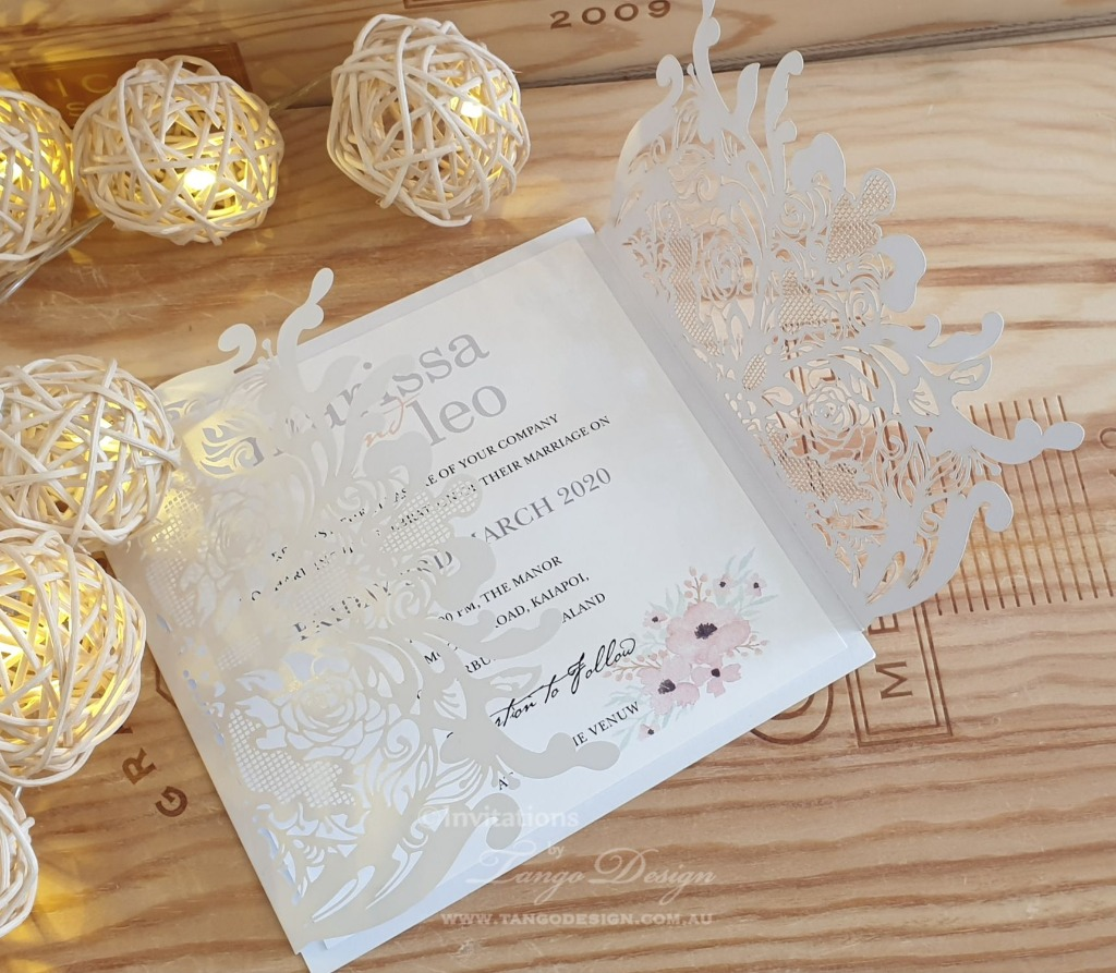 Botanical touch on laser cut wedding invitation. Custom design printed, fresh and beautiful.