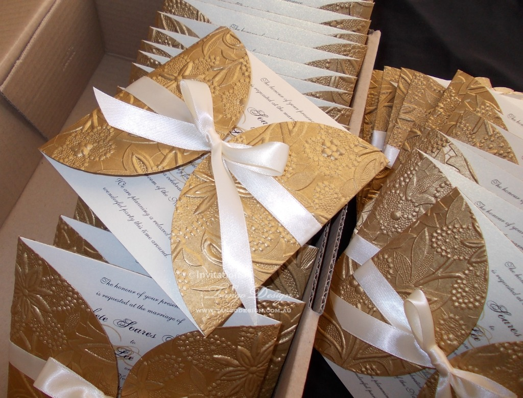 Golden tones and ivory. Wrap embossed invitations, floral or not floral pattern