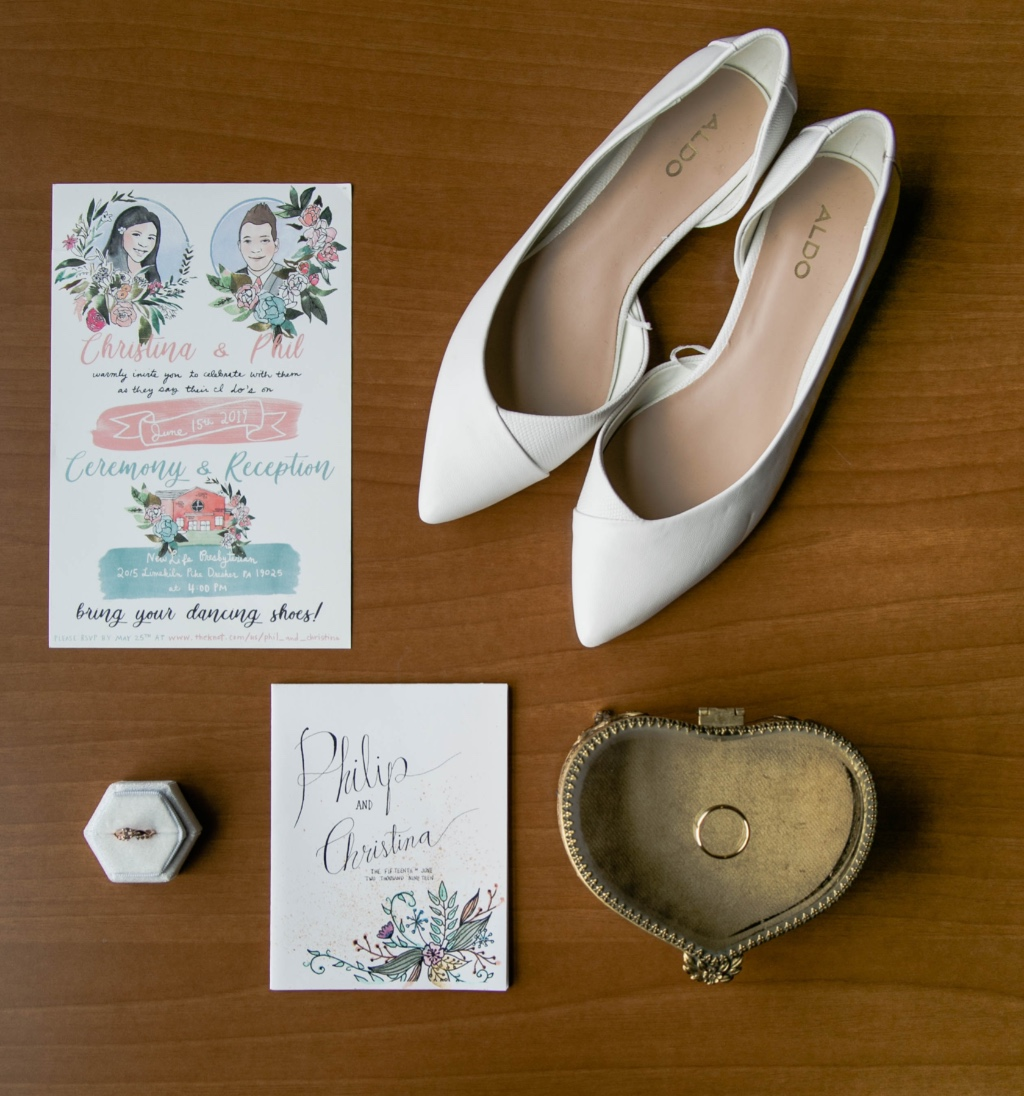 How amazing is the stationary in this image? Perfectly captured are the bride and groom in a fun and creative way by Gina.