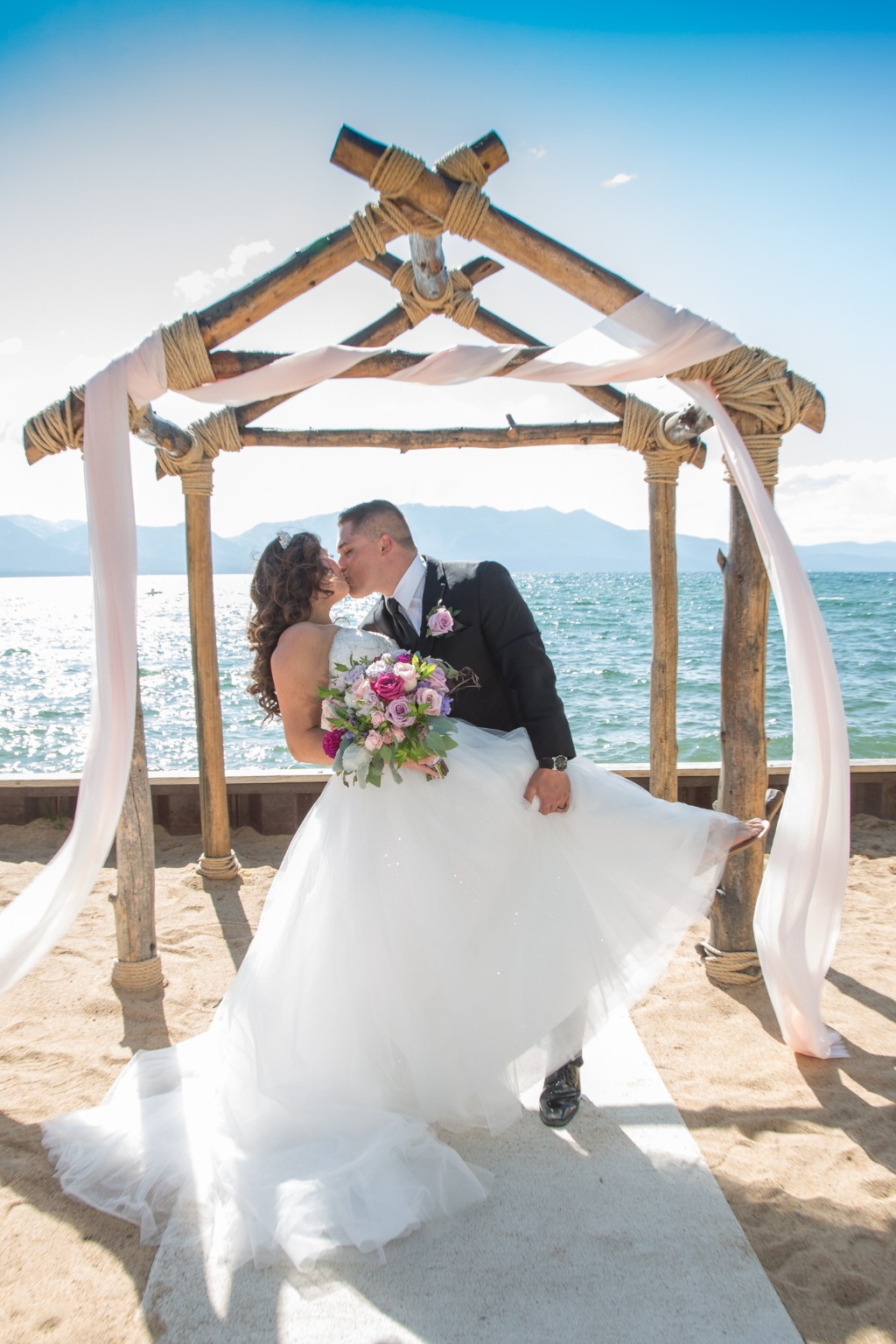 Is it any wonder why I love what I do? Romance, a striking couple, sparkling blue water, a gorgeous wedding at the lake, or the park
