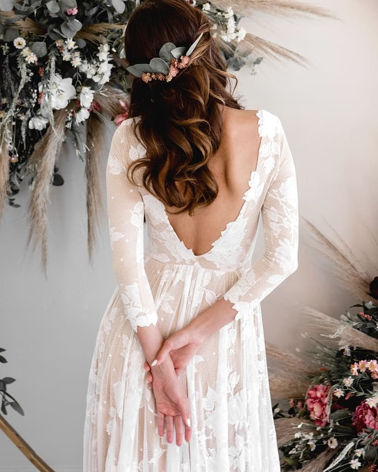 The ARI dress is soft and so delightful to wear. Our brides always tell us they put on their dress and never wanted to take it off