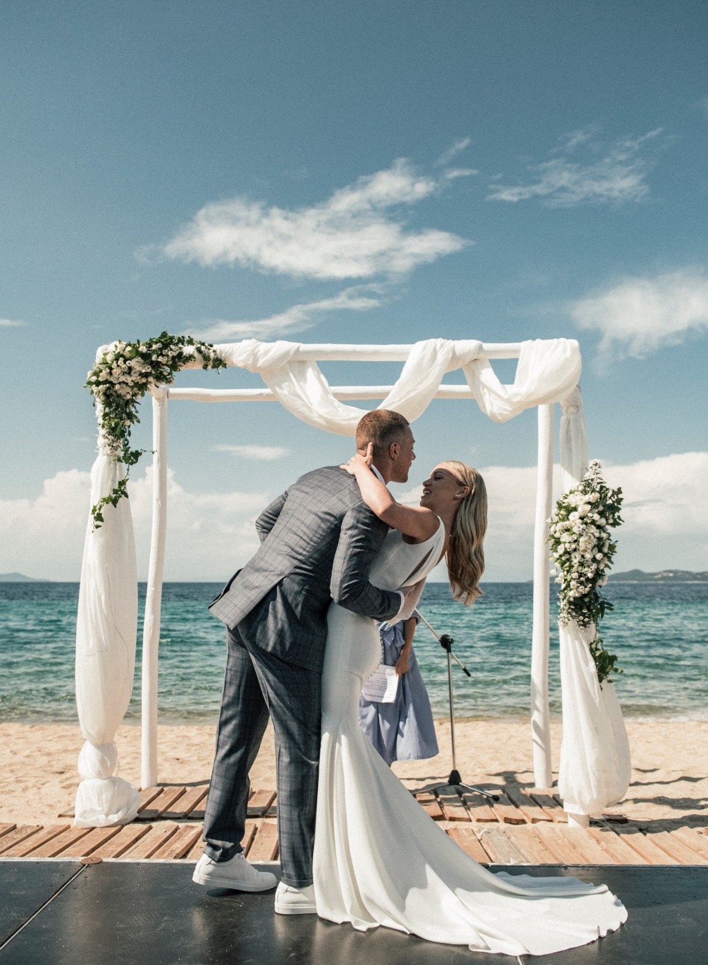 A chic beach wedding in Halkidiki, Greece. A chic floral arch in white with gold touches