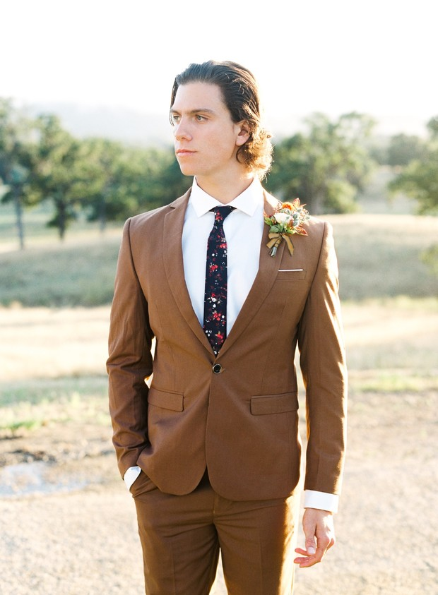 groom in brown wedding suit